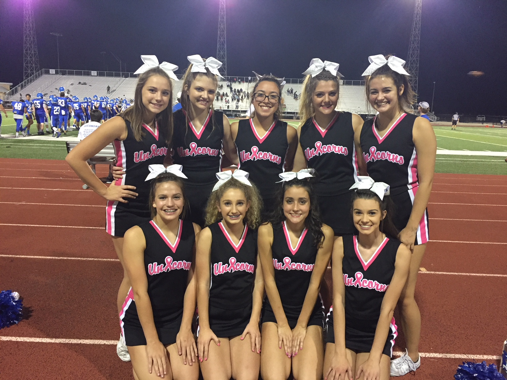 New Braunfels HIgh School JV Cheerleaders in their PInk Out uniforms