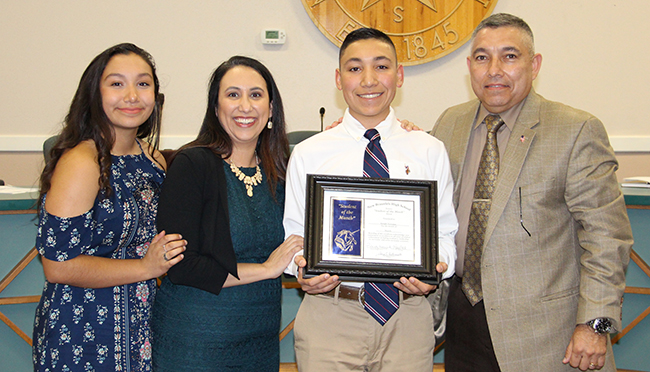 Joseph Terrones, NBHS Student of the Month for March 2018, with his family at the March 19, 2018, Board meeting.