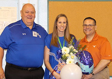 Superintendent Randy Moczygemba, District Elementary Teacher of the Year Lauren Bain and Carl Schurz Elementary Principal Duane Trujillo during the surprise visit to announce the district winner on April 9, 2018.
