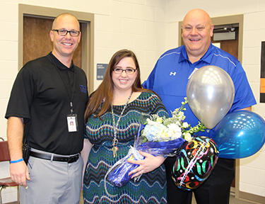NBMS Principal Greg Hughes, District Secondary Teacher of the Year Sara Trammell and Superintendent Randy Moczygemba during the surprise visit to announce the district winner on April 9, 2018.